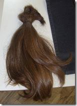 The four ponytails bundled together again.