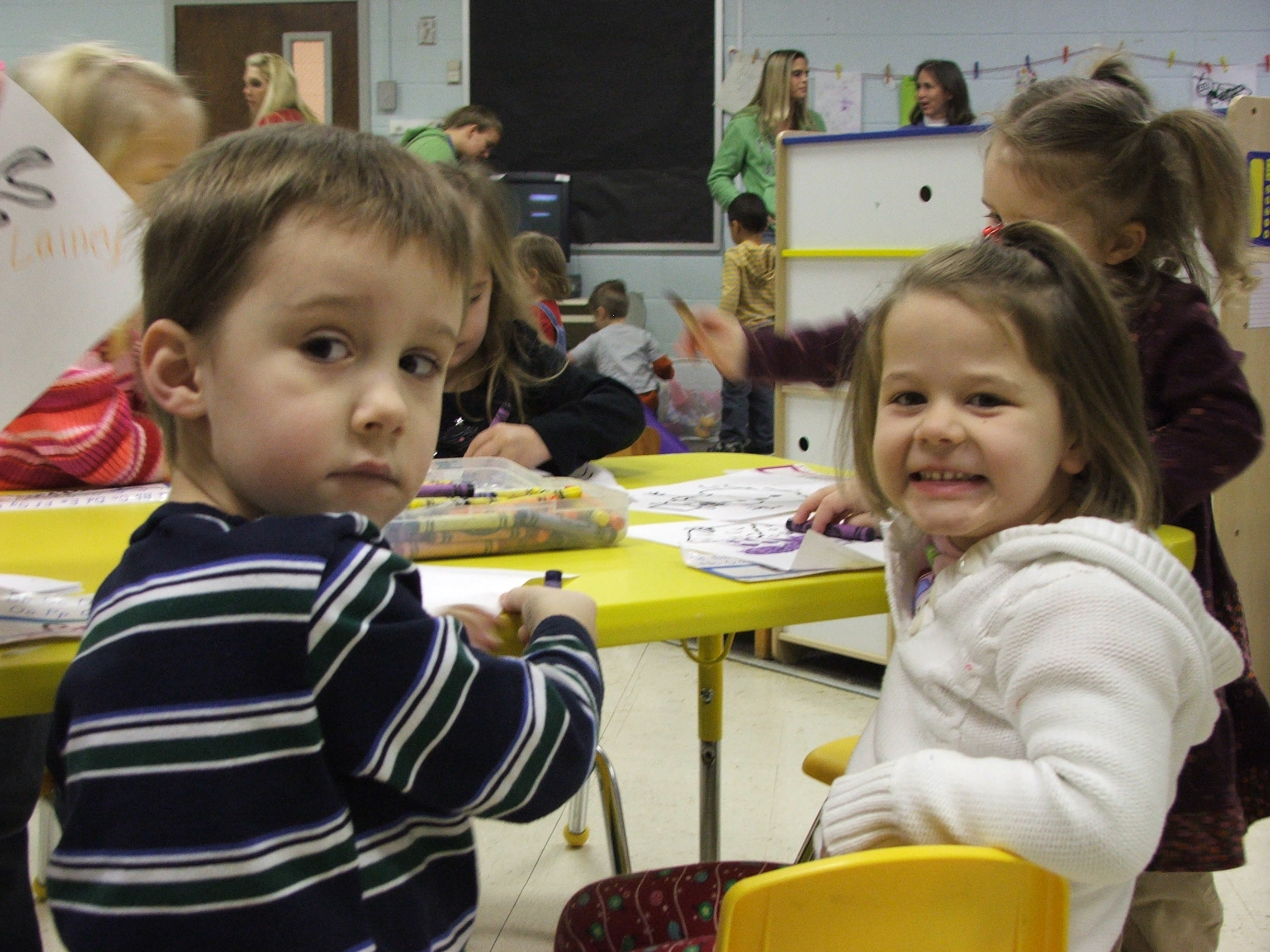 Christmas party with his ward friends (Hailey shown). Emma is in the background.